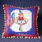 34004_thePHAGshop_Patriotic Petite Girl Pom Pom Pillow